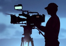 PHOTO: Silhouette of video camera and operator